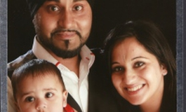 Kuly Ral with his wife and daughter