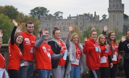 A group of supporters at The Twilight Walk in front of Warwick Castle