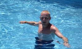 Steven Strange in the swimming pool