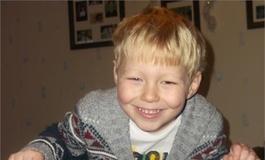 Alfie Thomas smiling