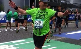 Travis finishing the Paris Marathon