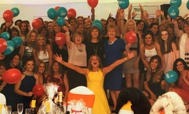 Female supporters with The Brain Tumour Charity balloons at a ladies lunch