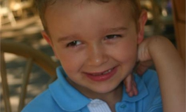Reece Nelson smiling at the camera on holiday