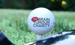 The Brain Tumour Charity golf ball on a tee ready for a charity golf day